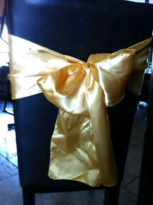Yellow gold chair sashes and table runners