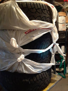 2 New snow tires on rims and 4 lightly used snow tires on rims