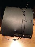 Console PS3 avec 2 manettes et jeux