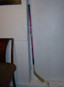 "Left Handed CCM Hockey Stick, good for 5'2"" a child or an adult."