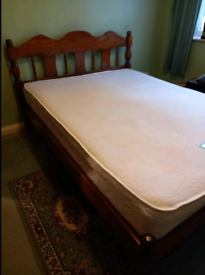 Dark brown pine double bed in excellent condition with mattress