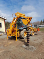 Backhoe and post hole auger