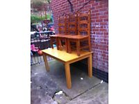 Solid oak table and 3 chairs