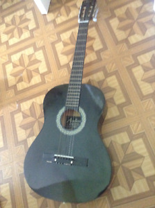 """Barely used 38"""" acoustic guitar with full set of spare strings"""