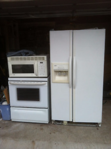 refrigerator, Stove and over the range microwave oven