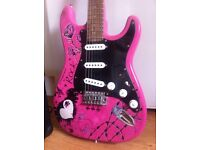 Pink full size electric guitar with amp and carry bag
