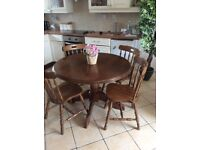 ROUND FAB SAMDED N REVARNISHED TOP TABLE AND FOUR CHAIRS