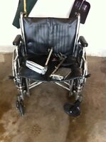 Like new large wheelchair with foot rests only $269