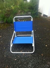 Low camping chairs. Dark blue canvas on aluminium frame.