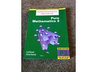 As & A Level Heinemann Modular Mathematics Book by Geoff Mannalll and Michael Kenwood.