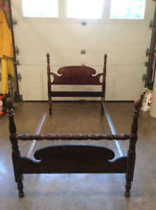 Two twin bed frames and two matching chairs.