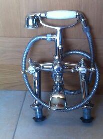 Bath mixer and basin taps.