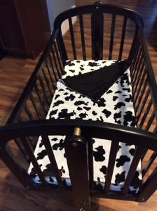 Black Ebony Rocking Cradle with castors