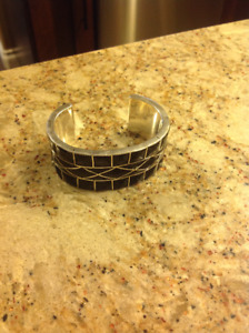 Silver and black bangle
