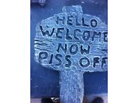Stone garden welcome sign.