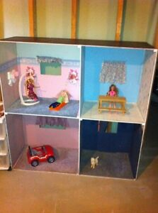 Barbie Doll house with car, dolls, and dog.