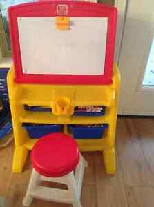 Child desk, built in storage bins and flips into white board