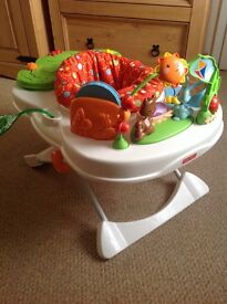 Great baby chair with two activity areas .