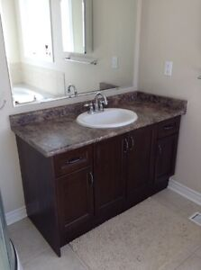 Bathroom counter, sink and faucet