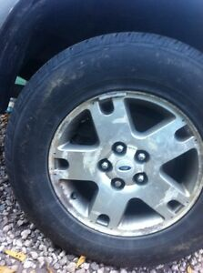 Ford escape alloy rims with 2 snow tires London Ontario image 1