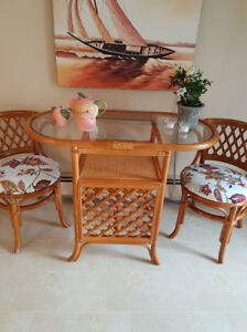 3 pc bamboo table with glass top. With upholstered chairs
