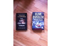 Two book. Paula Hawkins & Clive cussler - used condition.