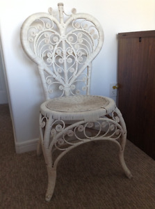 Beautiful white wicker chair and wicker garbage basket