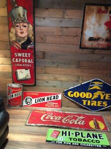 Tobacco and oil and gas signs and oil cans. Porcelain signs.