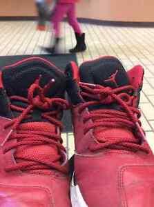 size 7 red and black jordans.