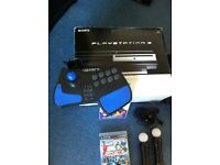 PS3 with 3 controllers and arcade pad with lots of games fully working and very good condition