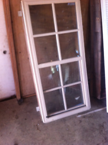 Double hung thermopane vinyl window approx 28in x 60in