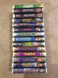 43 - VHS Tapes and DVD's - $1 each!