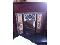 Fire surround and electric fire.