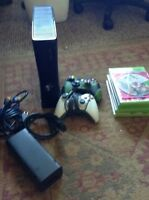 XboX 360 with remotes, games and HDMI cord