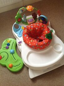 Baby's activity chair, with two sides to keep baby entertained.