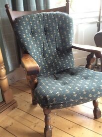 Solid oak armchair, with removable cushions. Excellent condition. Price reduced £60 ONO