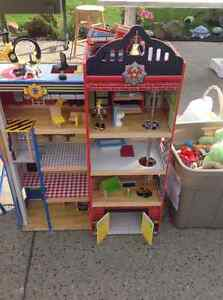 Wooden firehouse with furniture and fireman, helicopter and fire