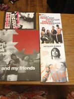 Assorted books red hot chili peppers and sid vicious