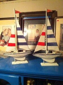 Two wooden sailboats