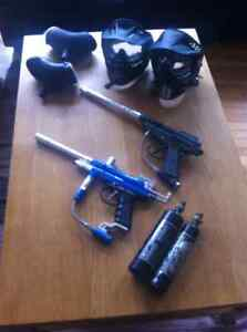 2 paintball markers, 2 hoppers, 2 masks, & 2 air tanks