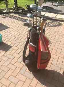 Gently used golf clubs and cart bag