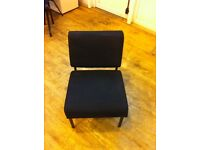 2 low black soft chairs