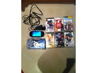 PSP & 6 games charger and new leather case