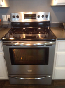 Stainless steel Frigidaire electric range (ceramic glass cooktop