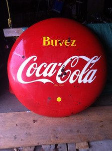 4 foot Coca Cola Coke button with rust and bullet holes