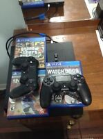 PS4 W/ 2 CONTROLLERS+ 3 GAMES + CHARGING DOC