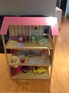 Three storey wooden Barbie doll house.