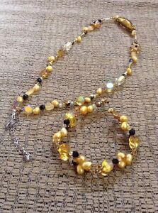 Amber / topaz necklace and bracelet - 20$