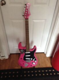 Full size pink electric guitar