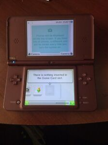 Red Nintendo ds xl is in 10/10 condition comes with charger